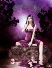 girl in purple dress sits by water