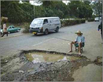 man fishing in flooded pothole