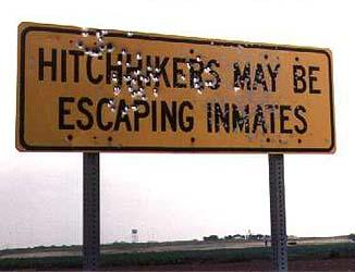 hitchhikers may be escaped inmates bullet sign